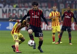 AC Milan's Kaka challenges Alves of Barcelona during their Champions League soccer match in Milan